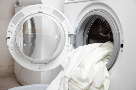 Some dirty clothes in the washing machine
