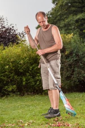 A Gardener starts to clean his garden. photo