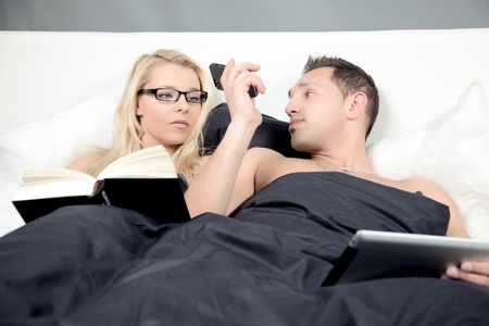 handover: A Business Man hands over the Phone call to her wife in there bed