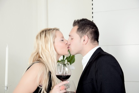 suitor: A romantic couple is kissing