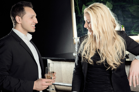 A young man flirts with a cute blond lady  Stock Photo