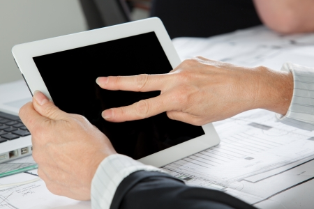 A gesture on a Tablet PC with two Fingers in a hotizontal position. photo