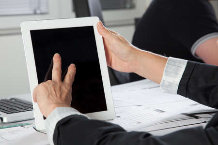 digitized: A gesture on a Tablet PC with two Fingers in a vertical position. Stock Photo