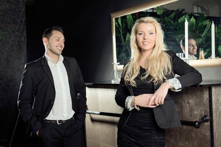 assignation: A elegant man is flirting with a pretty blond woman