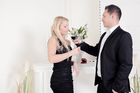 A young man wants to seduce the attractive young blond woman  photo
