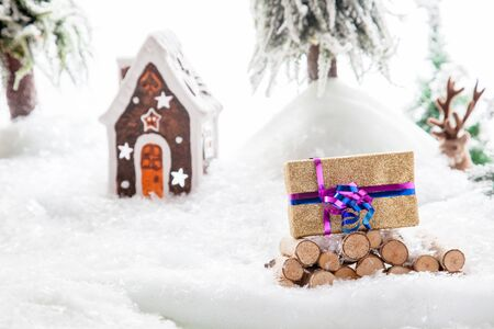 brushwood: A Christmas Gift stacked on a snowy woodpile within a winter landscape