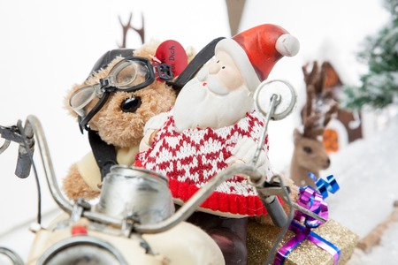 Santa Claus is driving through a snowy winter Scenery togeather with a dog as assistant driver  photo