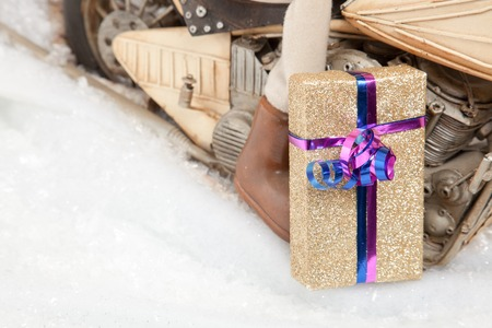 hoarfrost: A golden Christmas Present in front of a motorcycle with a lot of copyspace