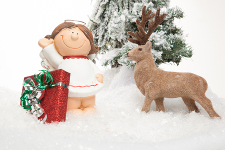 viewing angle: A Reindeer is fascinate from a cartoon underdressed girl