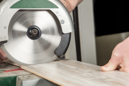 build buzz: A fast buzz is cutting a piece of laminate  Stock Photo
