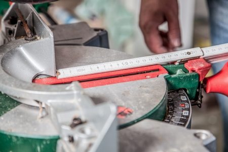 build buzz: A man is using a folding rule to measure the correct cutting length