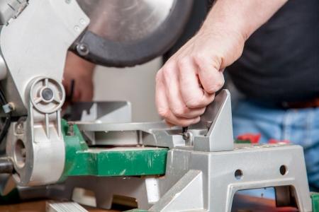 build buzz: A man is adjusting a metal saw