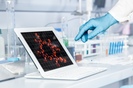 A Chemist is working on a electronic device to verify the atom structure