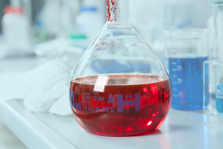 A chemical round bottom flask with a red Liquid  photo