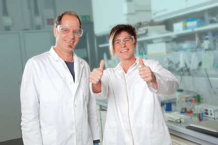 Two happy chemists Stock Photo - 25445710