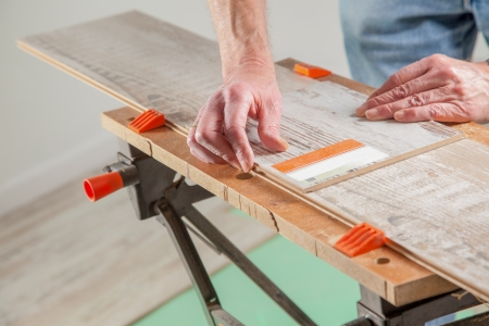 build buzz: A Carpenter is using a piece of laminate as ruler.