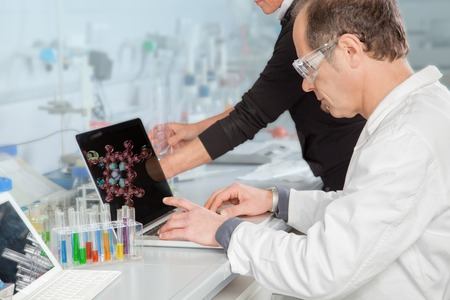 atomic structure: A Chemist is analyzing the atomic structure on his Laptop