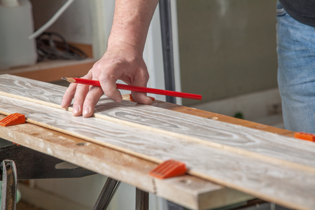 build buzz: A man chucked a piece of wood into the bench vice before sawing