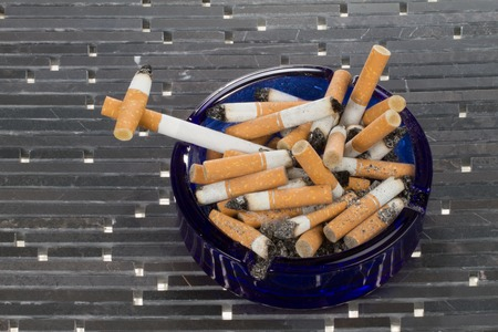 simulate: A cigarette is formed as a cross to simulate the dead behind smoking