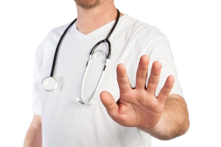 A Doctor use a stop gesture to prevent visitors to enter