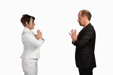 salutation: A couple of businesspeople are standing face to face for salutation  Stock Photo
