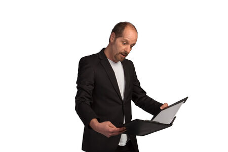 impressed: A Sales Manager is impressed while reading the new revenue values  Stock Photo
