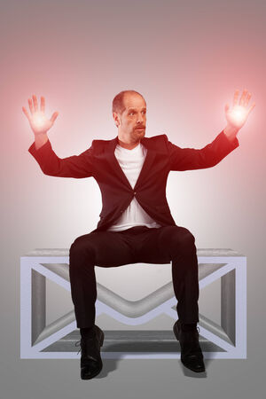 capabilities: A Businessman with some magic capabilities is sitting on a virtual mailbox  Stock Photo