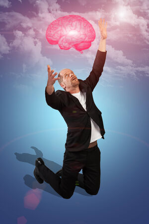 nowhere: A Businessman is catching a brain that seems to appear from nowhere  Stock Photo