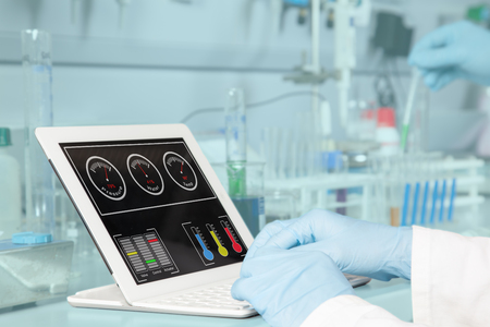 A chemist is analyzing the dashboard on his tablet pc