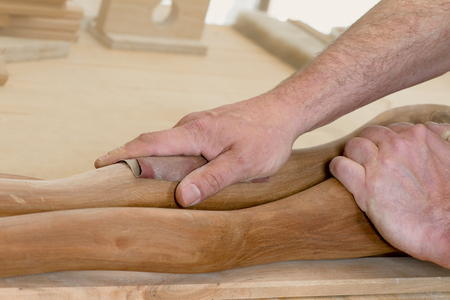 artistry: A Carpenter is polishing an artistry piece of wood. Stock Photo
