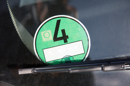 toxic emissions: A german green car environment badge to indicate that the car produce less toxic exhaust.