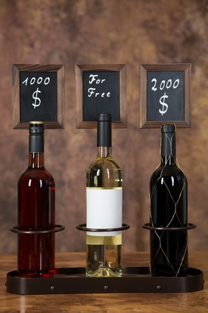 Three bottles of wine. One for free and two expensive wine bottles. Stock Photo