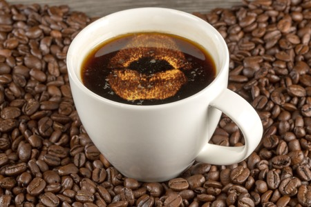 kissing mouth: A glowing kissing mouth inside a cup of coffee, decorated with beans