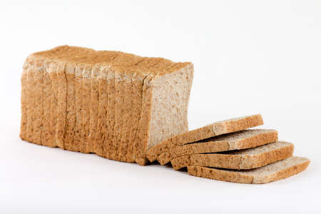 completely: A sideview from a bread for toasting completely sliced and stacked isolated on a white background.