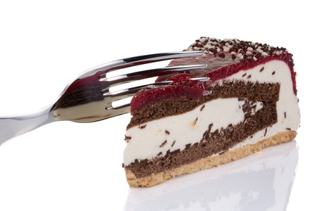 torte: A creamy cherry torte isolated on a white background.