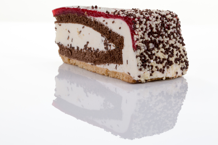 torte: A piece of cherry cream torte isolated on white with reflection
