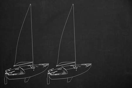 robust: Two sailing boots painted with white chalk on a dark chalkboard with some copyspace. Stock Photo