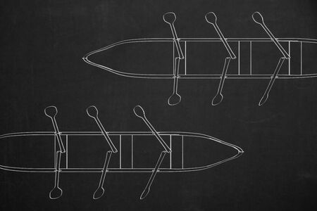 rowboats: A top view from two rowboats drawed with white chalk on a dark chalkboard. Stock Photo