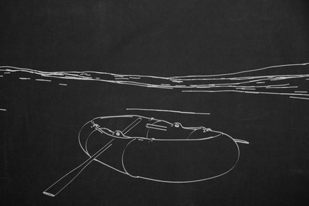 A chalk painting from a rubber boot on a dark chalkboard.