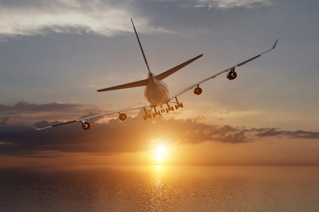 A 3d rendering from a back view of a big airliner in a sunset over the ocean.