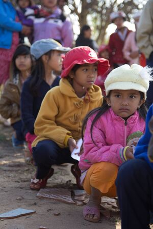 Lam Dong Province, Vietnam - January 24, 2015: The childrens face before receiving gifts of ethnic minority children in the highlands. T?t c? gift for poor children come from a charity group