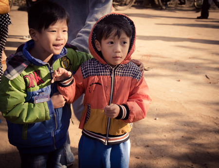 Lam Dong Province, Vietnam - January 24, 2015: The childrens face before receiving gifts of ethnic minority children in the highlands. T?t c? gift for poor children come from a charity group. Editorial