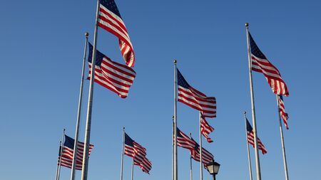 flagpoles: American Flags Waving On Flagpoles