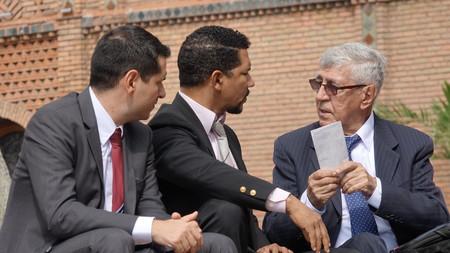 important: Business Men Discuss Important Documents Stock Photo