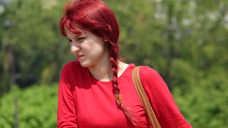 Confused Teen Girl With Red Hair