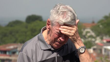 tearful: Sad And Tearful Old Man Or Senior Stock Photo