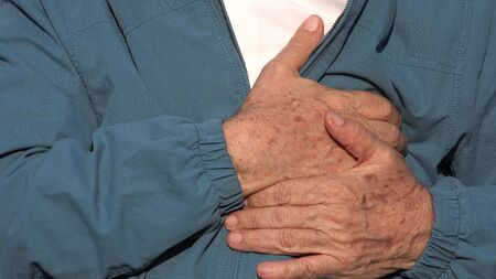 pains: Elderly Man Chest Pains Stock Photo