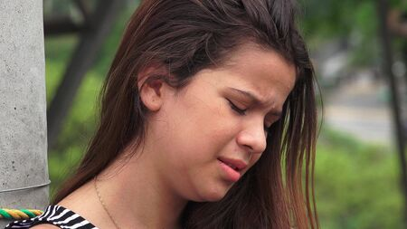 tearful: Hurt And Tearful Female Teen Stock Photo