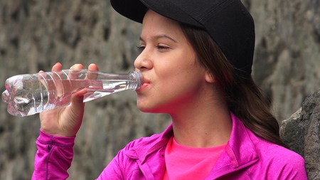 Female Teen Drinking Bottled Water Stock fotó