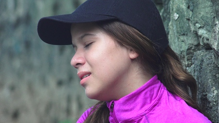 tearful: Tearful Girl With Sadness And Depression Stock Photo